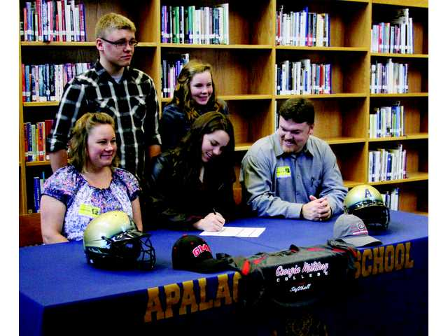 Apalachee's Painter signs softball scholarship