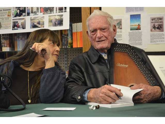 Local author entertains at book signing