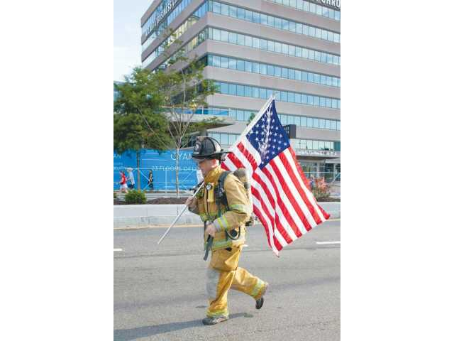 Barrow fireman runs Peachtree in full gear