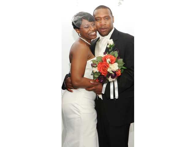 Miss Greene, Mr. Jones exchange vows