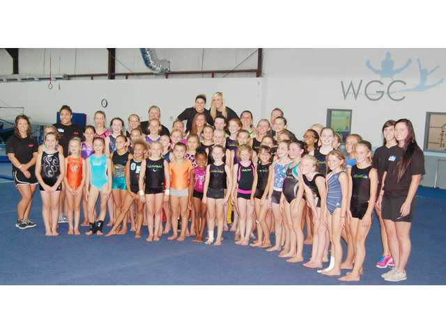 Gold medal gymnast visits Camden gym