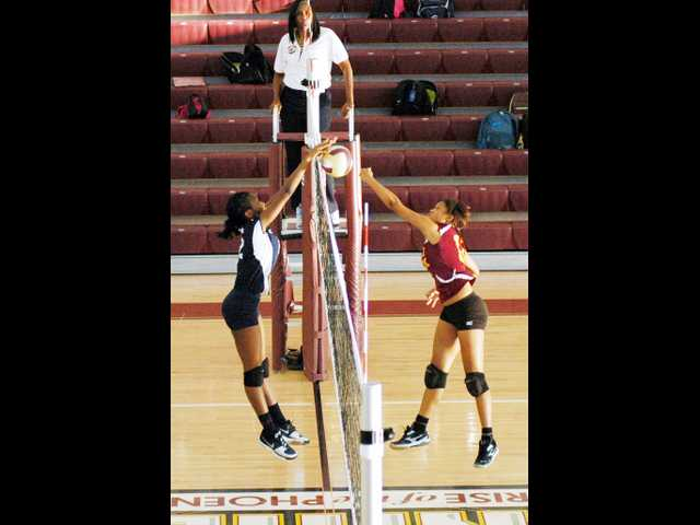ECHS volleyball nets sweep