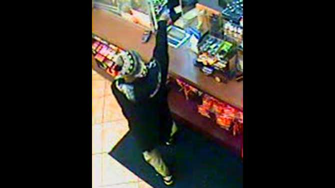 Police search for armed robber