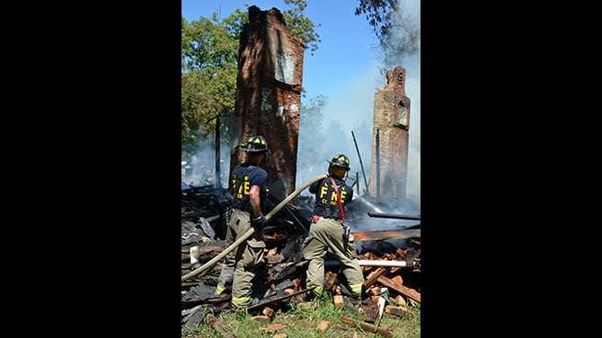 Vacant house ablaze near Salem Rd