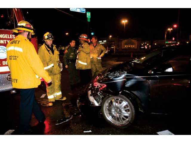 Two injured in collision at Magic Mountain Parkway