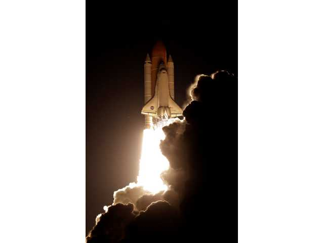 Space shuttle Discovery blasts off on historic mission