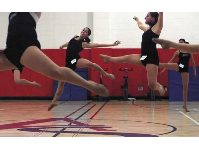 Famous choreographer steps out with local dance team