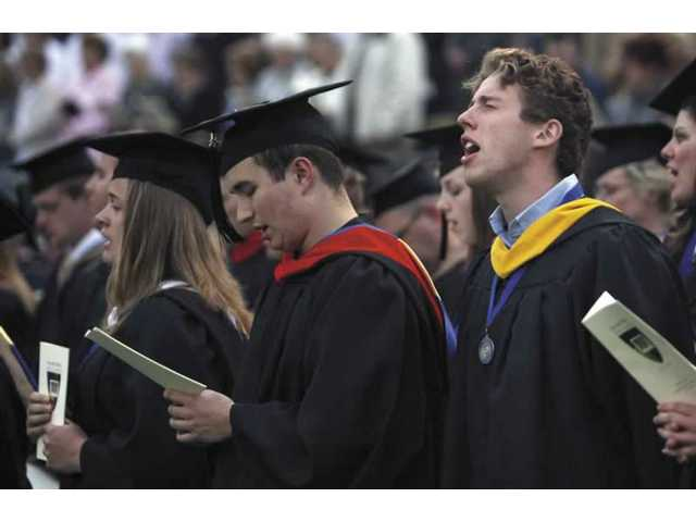 Nearly 300 receive degrees