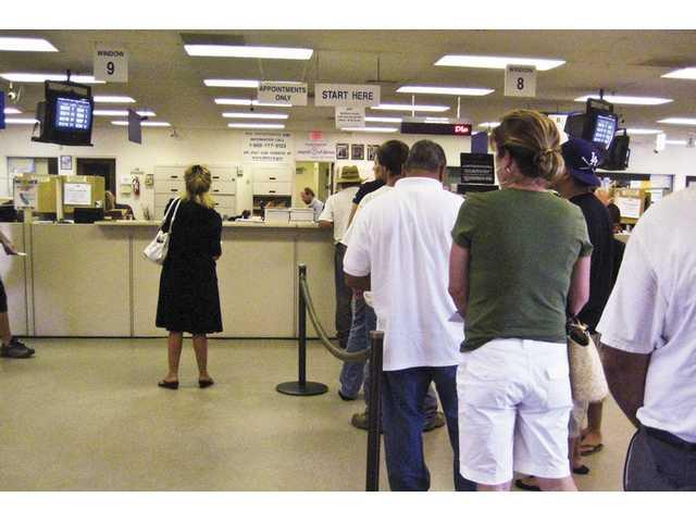 DMV cuts hours in budget crisis