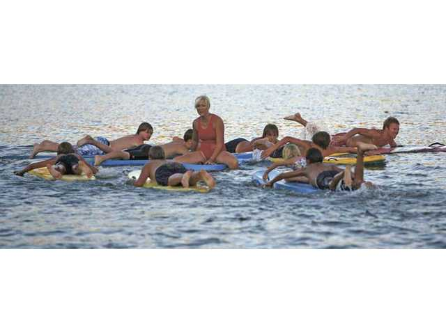 Junior lifeguards take parents in 'Macho Man' competition
