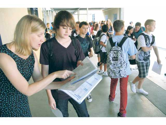 Old friends, new faces head back to school