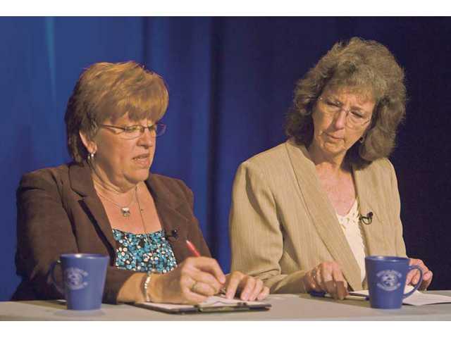 Candidates for COC board debate over college's future