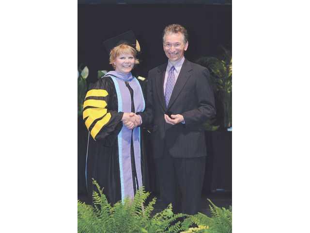 Joel Miller, D.M.D. receives prestigious LLSR award