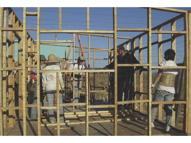 Church members build home