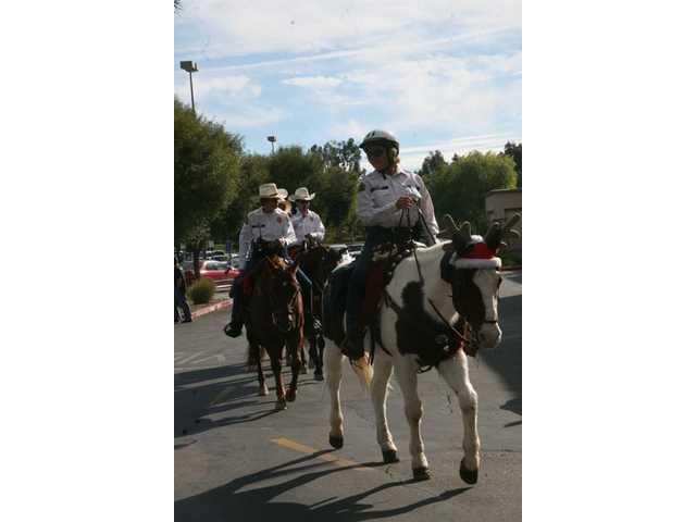 Horseback posse spreads smiles