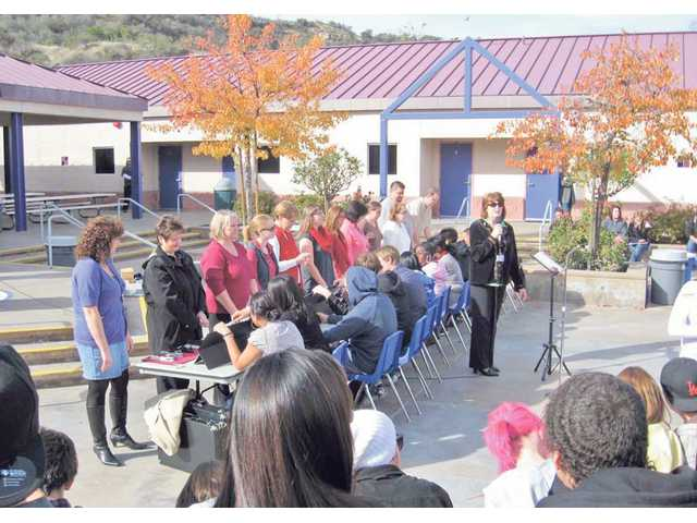 Hart district employees perform for students