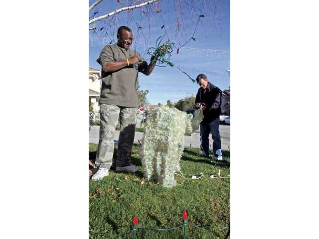Residents take down holiday  decorations