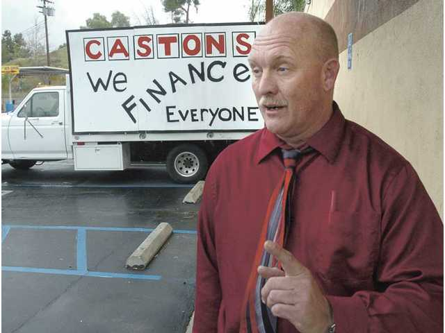 A (parking) lot of trouble: Caston's owners cited for parking-lot sales, which city sees as blight