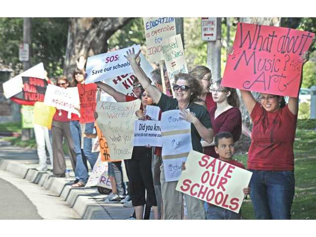 Teachers protest cuts in front of City Hall