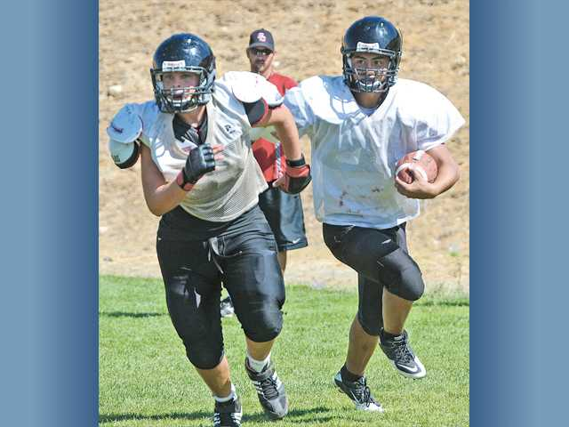 Prep football: Playing catch-up