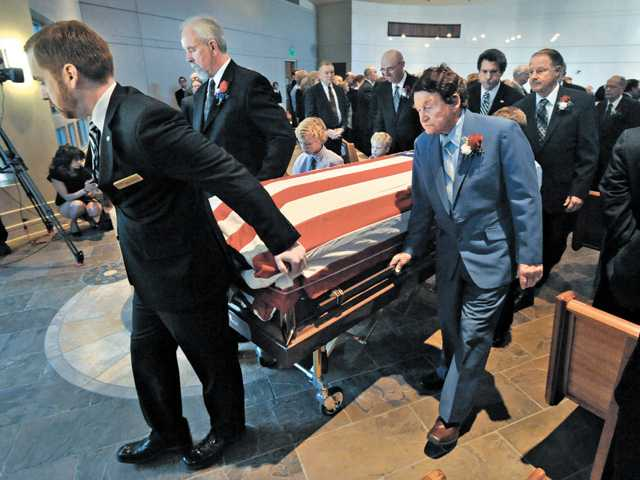 Mourners celebrate life of former leader