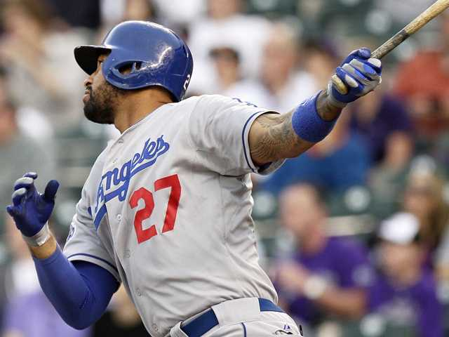 MLB: Rockies triple up Dodgers