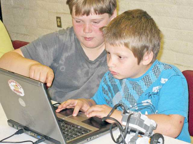 Kids learn with robot creations