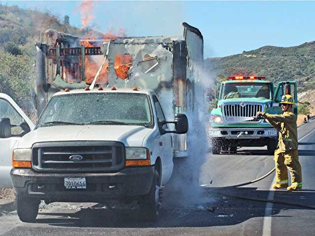 UPDATE: Truck fire ignites brush in Tejon Pass
