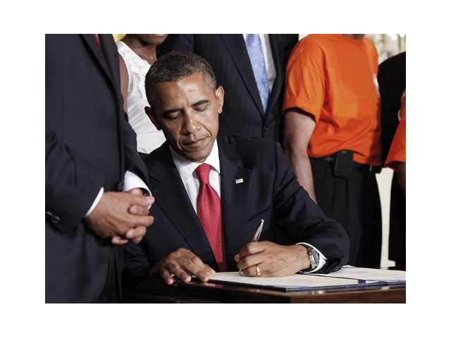 Obama signs student loan, road-building bill