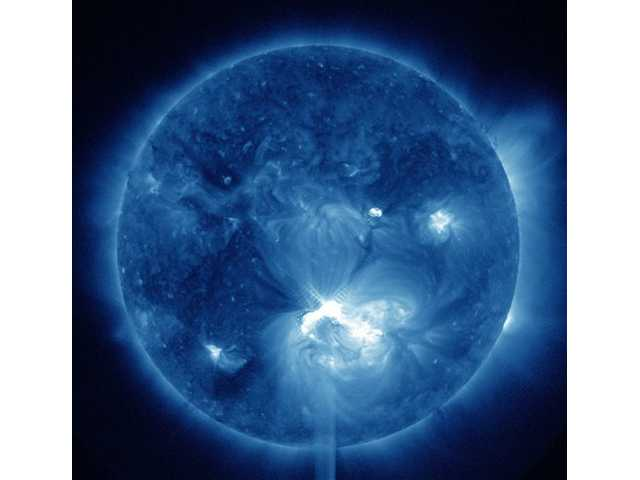 Large solar flare erupts; little impact to Earth