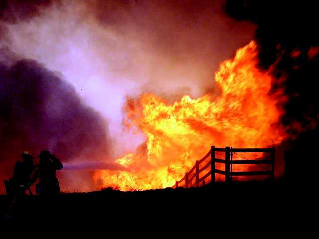 Fire burns home, threatens others in rural SoCal