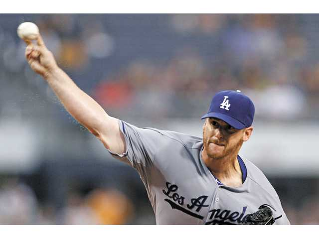 MLB: Dodgers beat Pirates 11-0 behind Billingsley