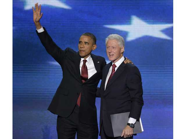 Clinton boosts Obama in rousing convention speech