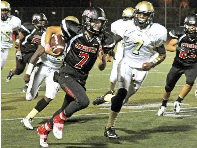 Prep football: Cardinals keep rolling