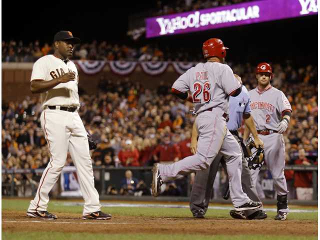 MLB: Reds lose ace, win first playoff game in 17 years