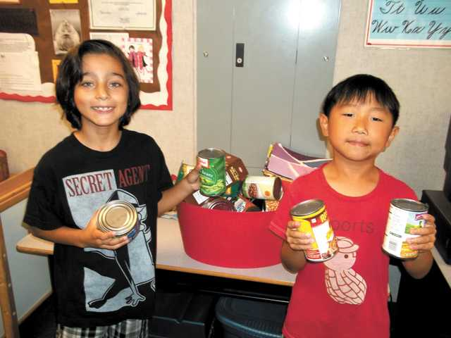 3rd-graders collect cans