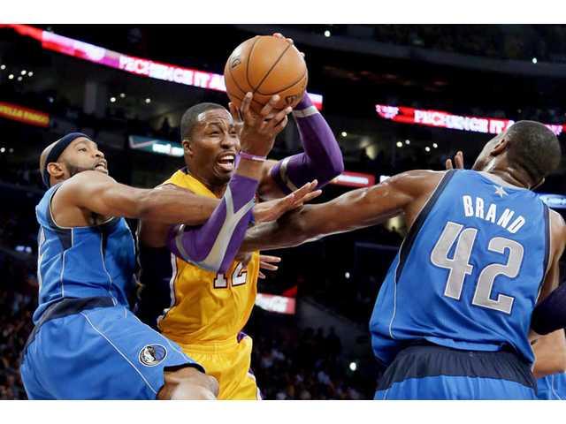 NBA: Dallas stuns loaded Lakers in opener, 99-91