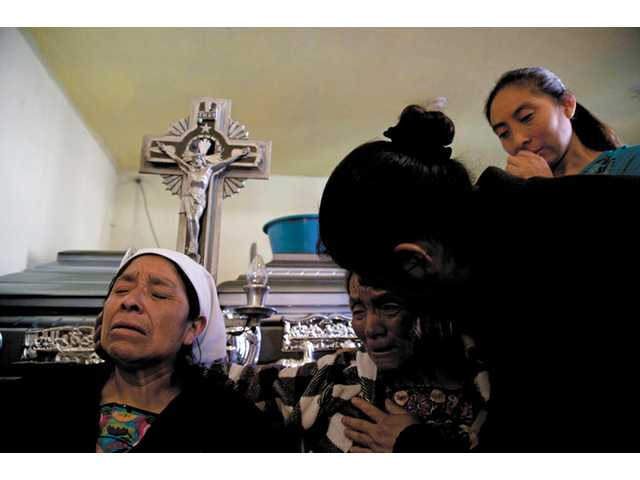 Villagers mourn family; Guatemala quake toll at 52
