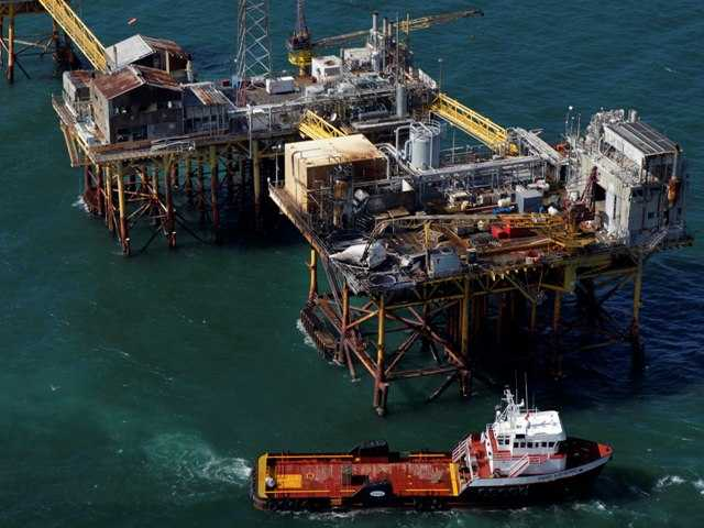 2 missing, 4 badly burned in Gulf platform fire