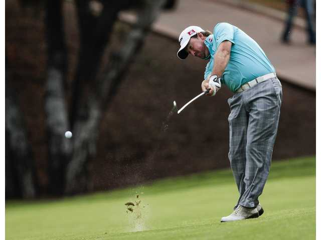Golf: McDowell takes three-stroke lead at World Challenge
