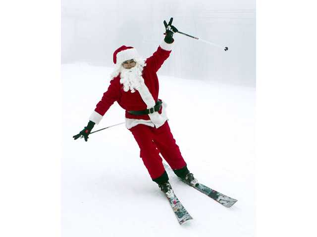 Skiing Santas hit the slopes in Maine 