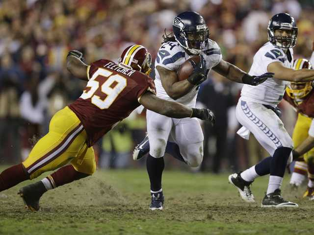 NFC wild card: RG3 hurt, Seattle tops Redskins 24-14 in playoffs