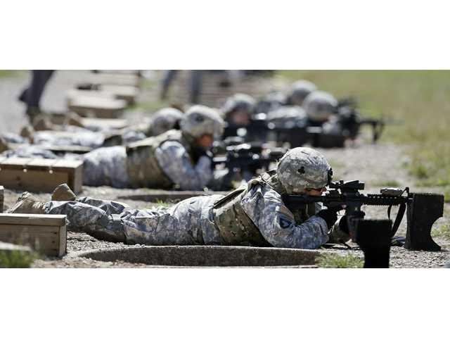 Women in combat face doubts over emotions, ability 