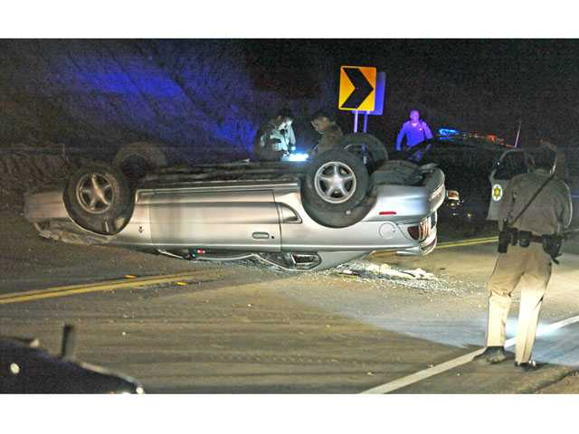 Driver hospitalized in rollover crash