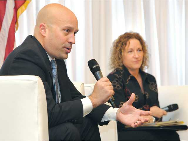 Panel helps businesses deal with healthcare reform