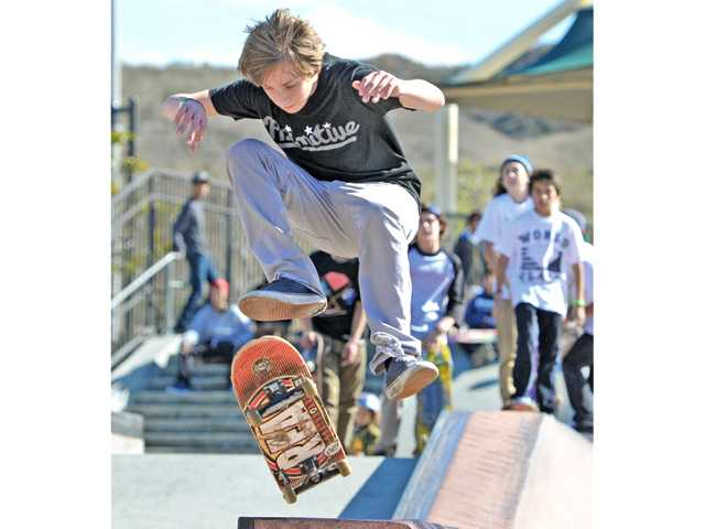 Participants flip for skateboard competition