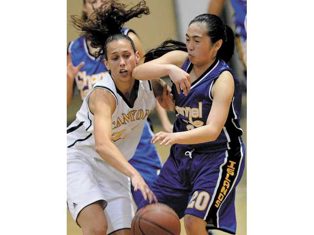 Prep girls hoops: The Cowboys' three spree