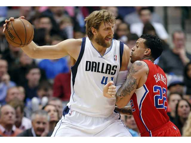 Mavericks beat Clippers in OT