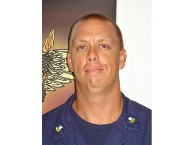 APNewsBreak: Coast Guardsman gets desertion charge