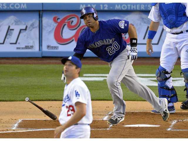 Rockies rout Dodgers